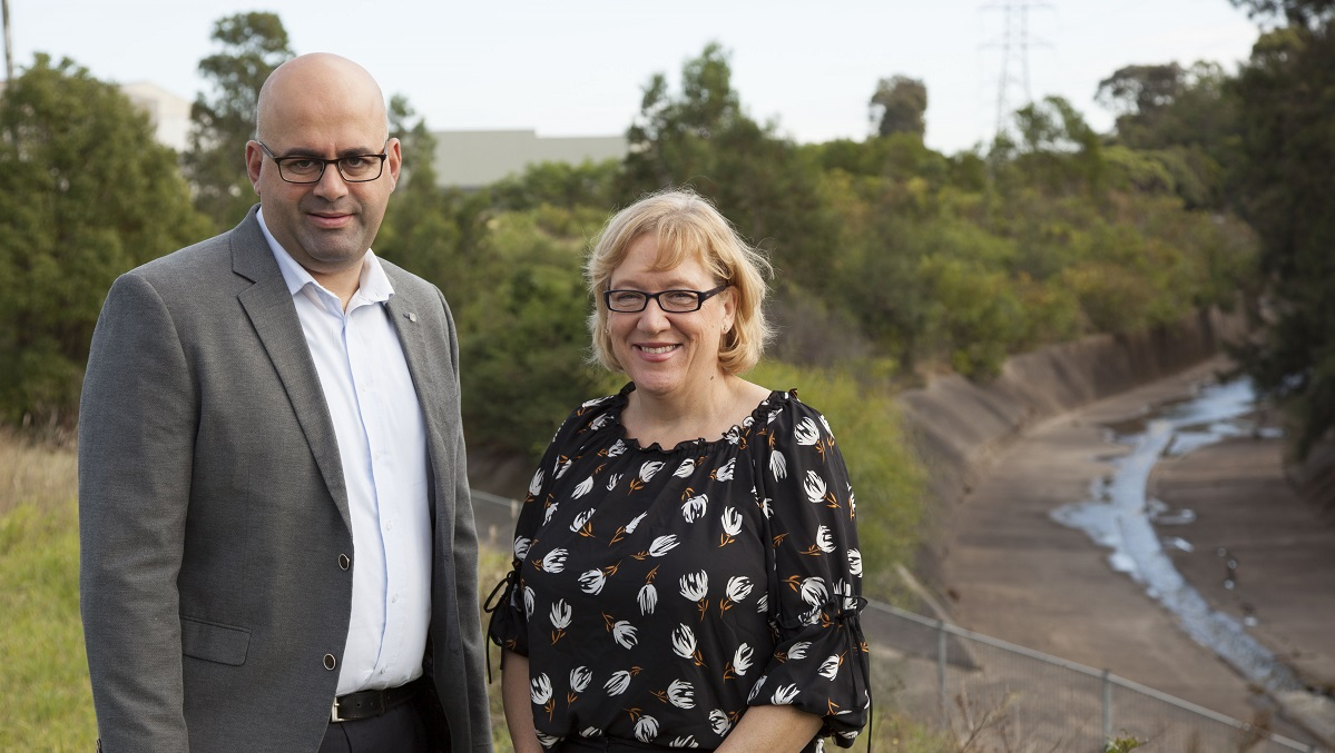 Cooks River Alliance Deputy Chair, Strathfield Councillor Maryanne Duggan, and Canterbury Bankstown Mayor Khal Asfour, stand at the junction of Coxs Creek and the Cooks River